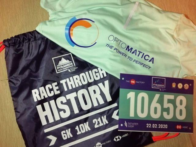 a t-shirt and bag of optomatica at the pyramids half marathon