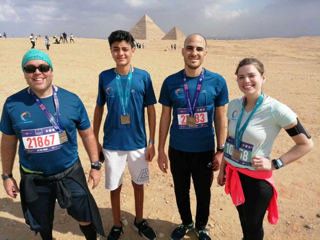 Dr. Mohammed El-Beltagy FOUNDER AND CEO and optomatica team in n the Pyramids Half Marathon 2020