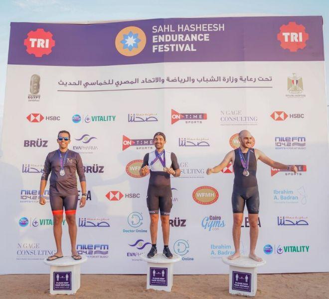 the top three men standing at podium at sahl hasheesh endurance festival